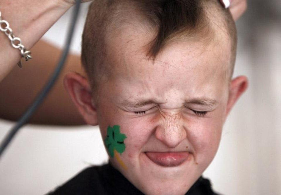 Photo -  HEAD SHAVE, SHAVING, ST. BALDRICK'S DAY: Ryan Baker, 9, grimaces while he get his hair shaved during St. Baldrick's on Sunday, March 30, 2008, in Oklahoma City, Okla. BY SARAH PHIPPS, THE OKLAHOMAN  ORG XMIT: KOD