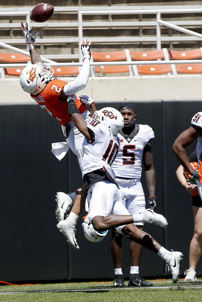 Photo - Oklahoma State's Tylan Wallace (2) goes up for catch as OSU's Thomas Harper (10) defends during the Oklahoma State Cowboys spring practice at Boone Pickens Stadium in Stillwater, Okla., Saturday, April 20, 2019.  Photo by Sarah Phipps, The Oklahoman