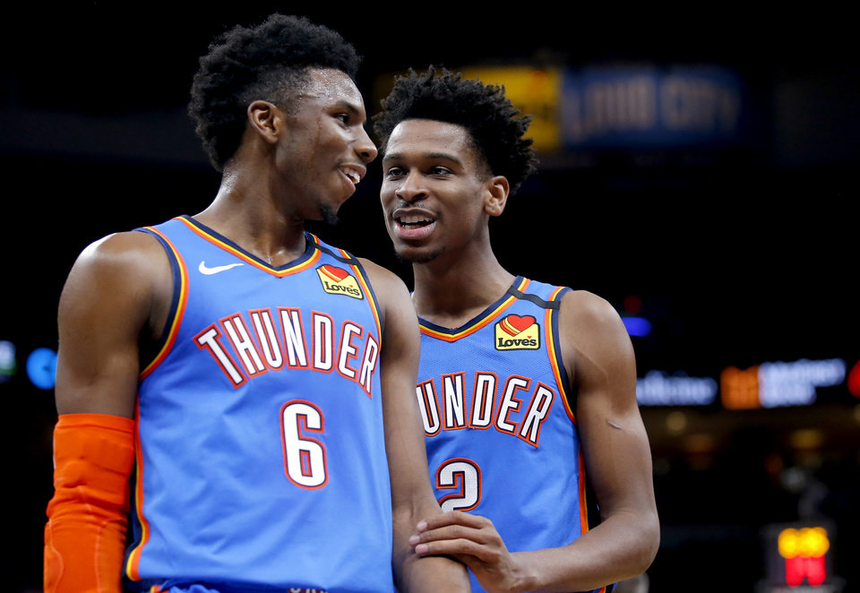 Photo - Oklahoma City's Hamidou Diallo (6) and Shai Gilgeous-Alexander (2) react during the NBA basketball game between the Oklahoma City Thunder and the Atlanta Hawks at the Chesapeake Energy Arena in Oklahoma City,Friday, Jan. 24, 2020.  [Sarah Phipps/The Oklahoman]