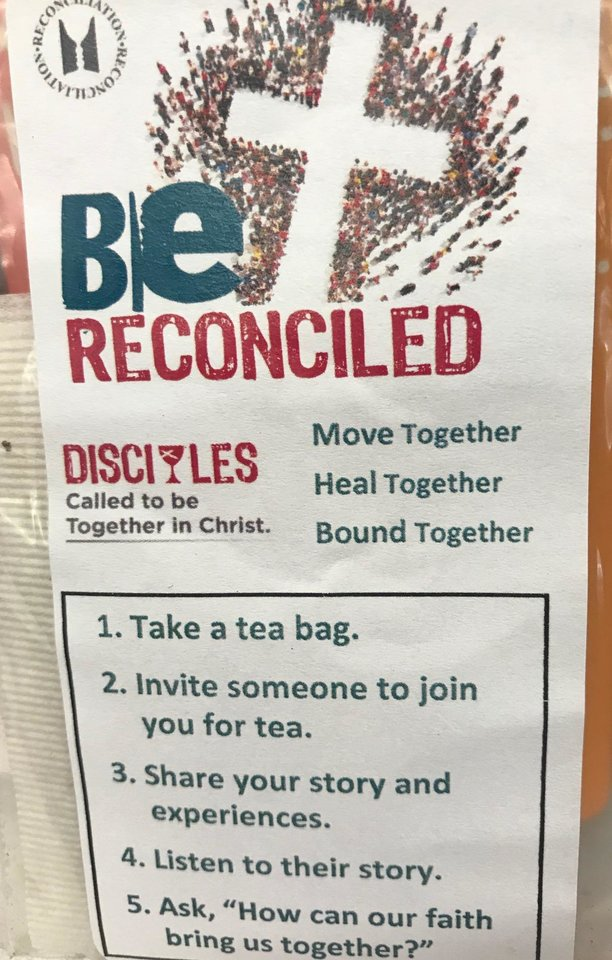 Photo -  Tea bags with a reconciliation message are distributed on Sept. 30 to attendees at Wildewood Christian Church (Disciples of Christ). [Photo by Carla Hinton, The Oklahoman]