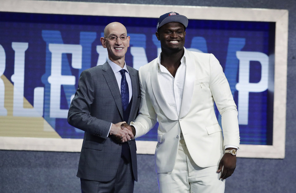 Photo - Duke's Zion Williamson, right, poses for photographs with NBA Commissioner Adam Silver after being selected by the New Orleans Pelicans as the first pick during the NBA basketball draft Thursday, June 20, 2019, in New York. (AP Photo/Julio Cortez)