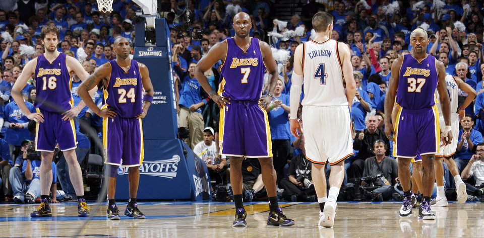 Photo - L.A.'s Pau Gasol (16), Kobe Bryant (24), Lamar Odom (7) and Ron Artest (37) stand on the court as Nick Collison (4) of Oklahoma City walks by late in the fourth quarter during the basketball game between the Los Angeles Lakers and the Oklahoma City Thunder in the first round of the NBA playoffs at the Ford Center in Oklahoma City, Thursday, April 22, 2010. Oklahoma City won, 101-96. [Nate Billings/The Oklahoman]