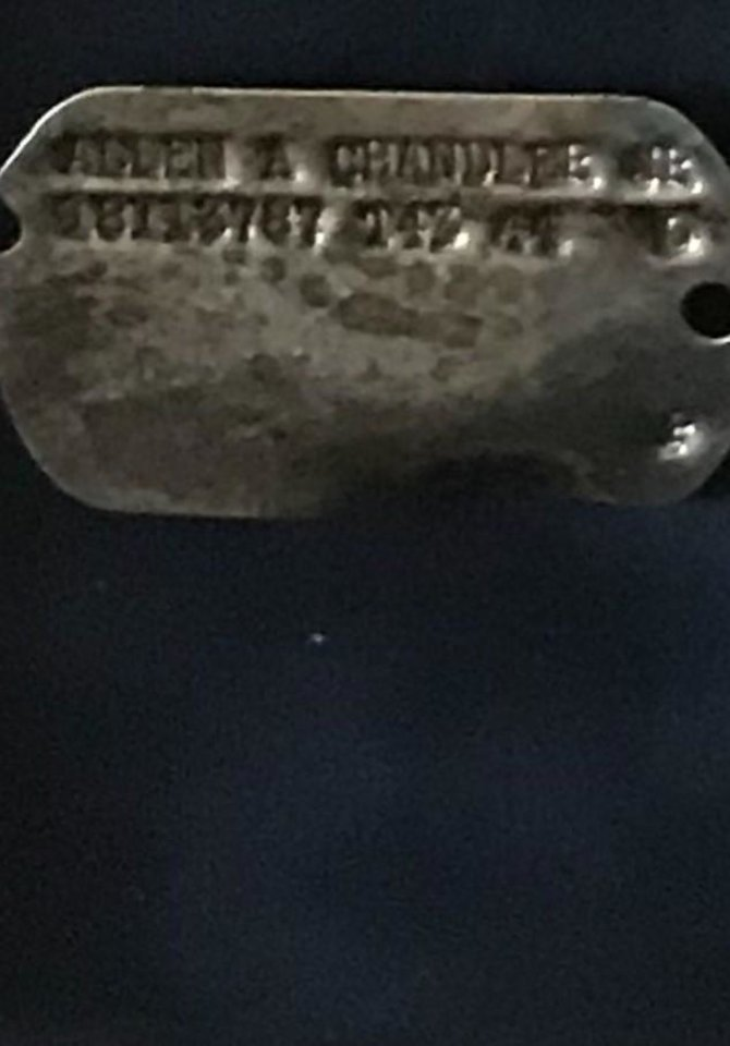 Photo -  Allen Chandler's dog tag, recovered from the site of his crashed B-17 bomber. [Photo Provided]