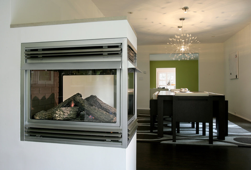 Modern fireplace designers use tumbled glass or river stone gas