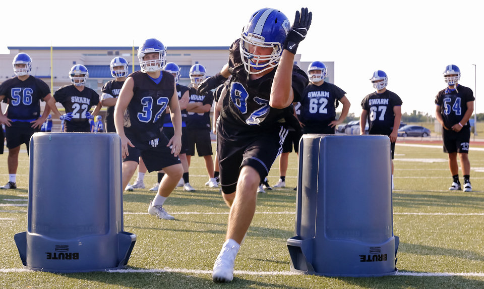 Photo - Players run through defensive line drills during the Deer Creek High School football practice in Edmond, Okla. on Wednesday, Aug. 10, 2016. Photo by Chris Landsberger, The Oklahoman