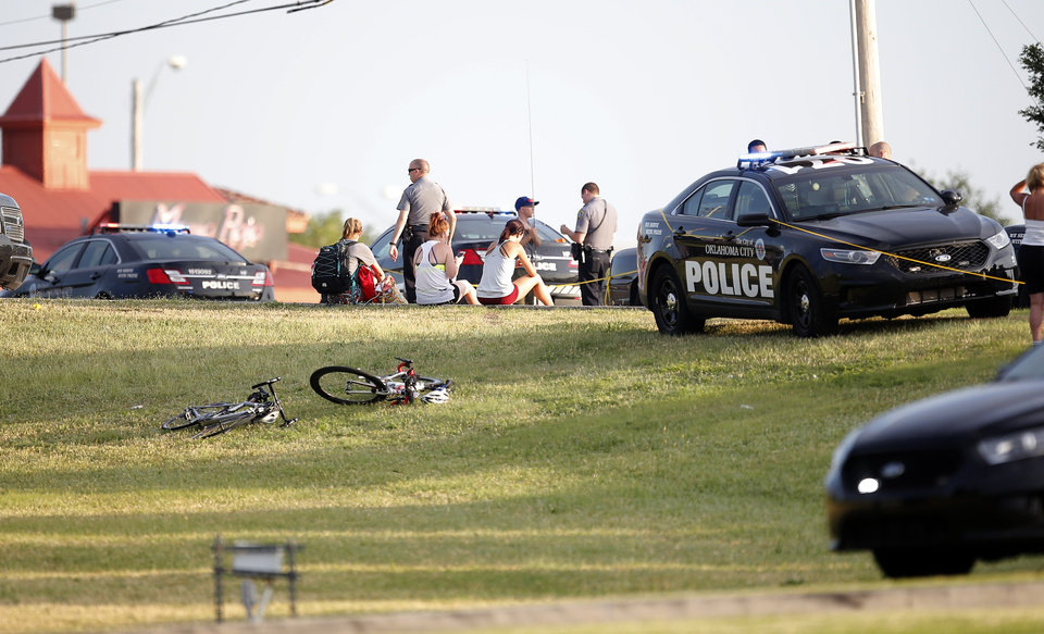 Photo - Police and emergency personal surround the scene of a shooting on the east side of Lake Hefner in Oklahoma City, Thursday, May 24, 2018.  Photo by Sarah Phipps, The Oklahoman