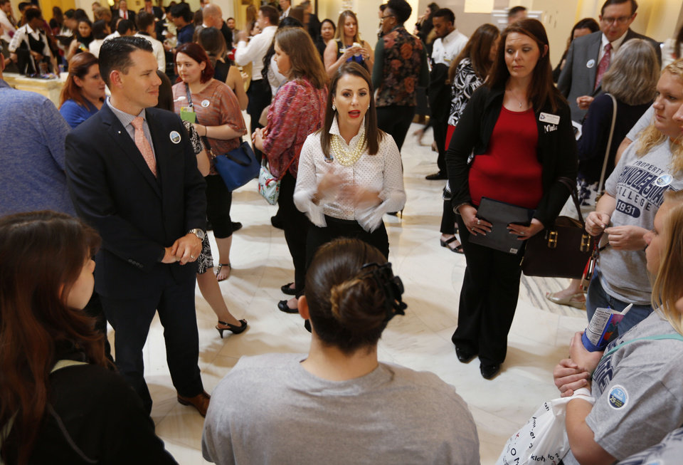 Photo -  Sen. Jason Smalley, left, and Rep. Katie Henke, center, speak to Oklahoma's Promise scholarship recipients during an event in support of the program Tuesday at the state Capitol. [Photo by Paul Hellstern, The Oklahoman]