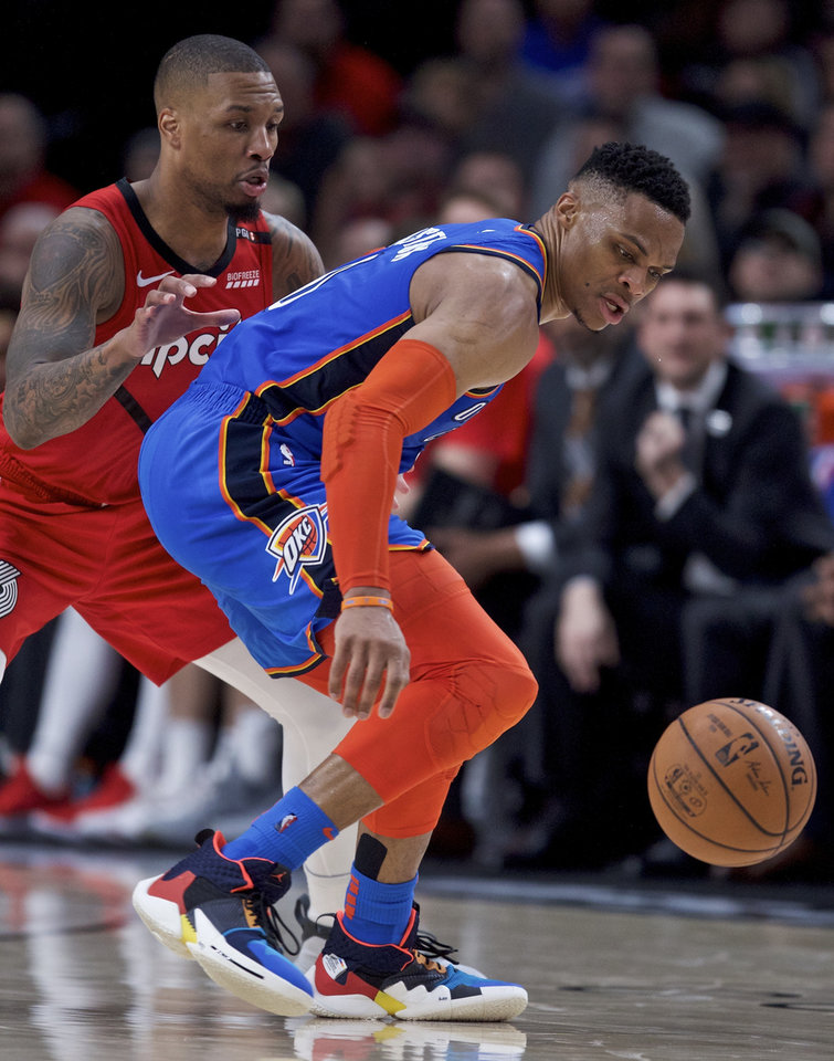 Photo - Oklahoma City Thunder guard Russell Westbrook, right, loses the ball in front of Portland Trail Blazers guard Damian Lillard during the second half of an NBA basketball game in Portland, Ore., Friday, Jan. 4, 2019. The Thunder won 111-109. (AP Photo/Craig Mitchelldyer)