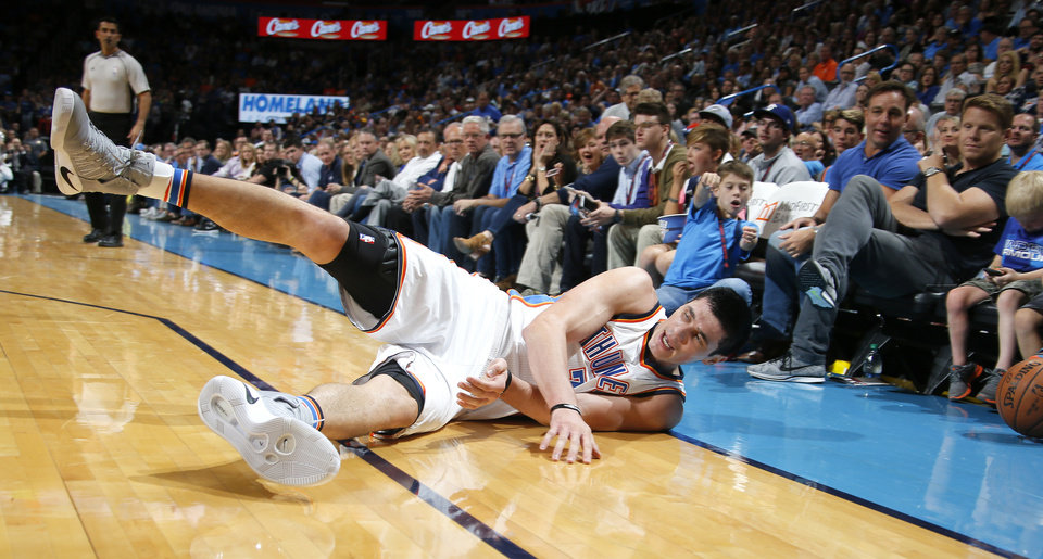 Photo - Oklahoma City's Ersan Ilyasova (7) dives for the ball during an NBA basketball game between the Oklahoma City Thunder and the Phoenix Suns at Chesapeake Energy Arena in Oklahoma City, Friday, Oct. 28, 2016. Photo by Bryan Terry, The Oklahoman
