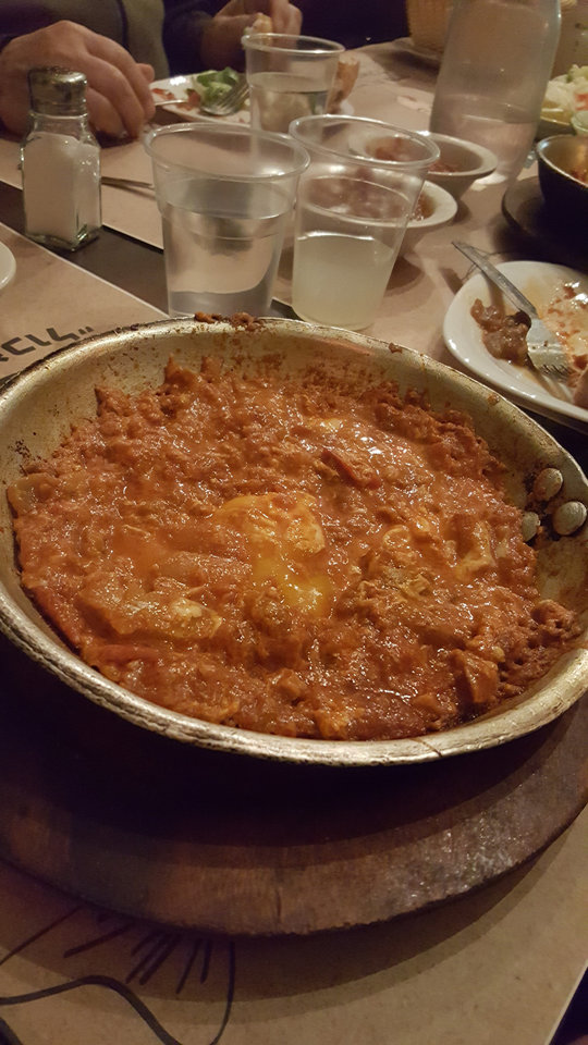 Photo - A dish of Shakshuka awaits diners at a restaurant in Israel. [Photo by Carla Hinton, The Oklahoman]