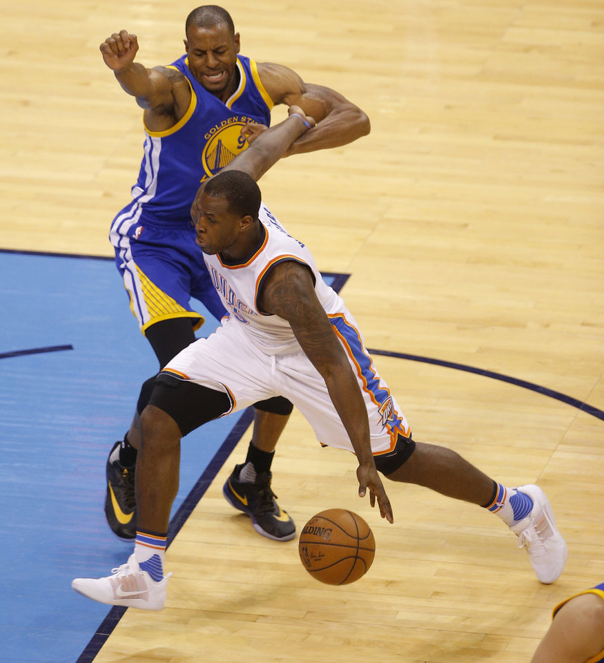 Photo - Oklahoma City's Dion Waiters (3) goes past Golden State's Andre Iguodala (9) during Game 6 of the Western Conference finals in the NBA playoffs between the Oklahoma City Thunder and the Golden State Warriors at Chesapeake Energy Arena in Oklahoma City, Saturday, May 28, 2016. Photo by Bryan Terry, The Oklahoman