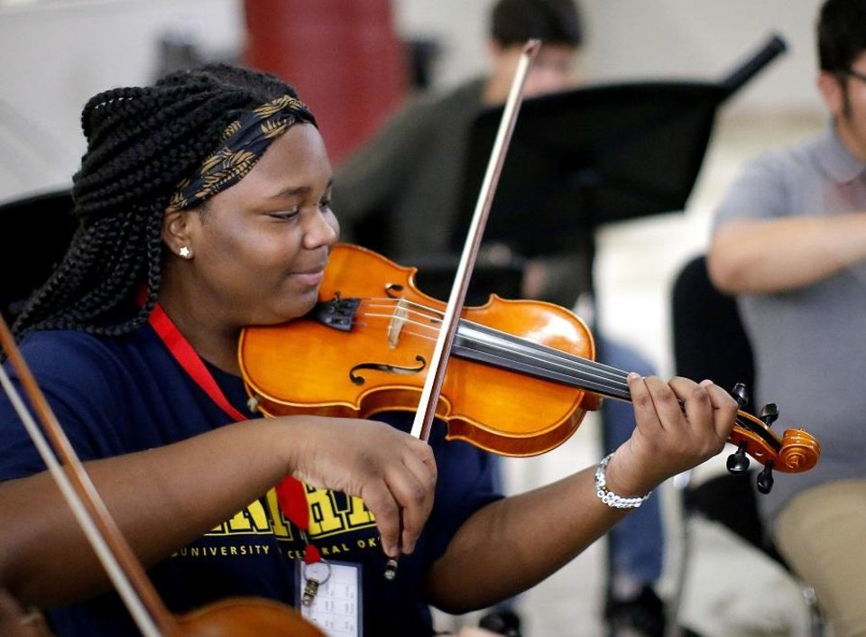 Photo - Amaury McCarer practices with El Sistema Oklahoma at First Presbyterian Church of Oklahoma City in Oklahoma City, Thursday, Sept. 19, 2019. She is a member of the program's new La Sala Musical ensemble, which will perform Saturday as part of the grand opening celebration for Scissortail Park. [Sarah Phipps/The Oklahoman]