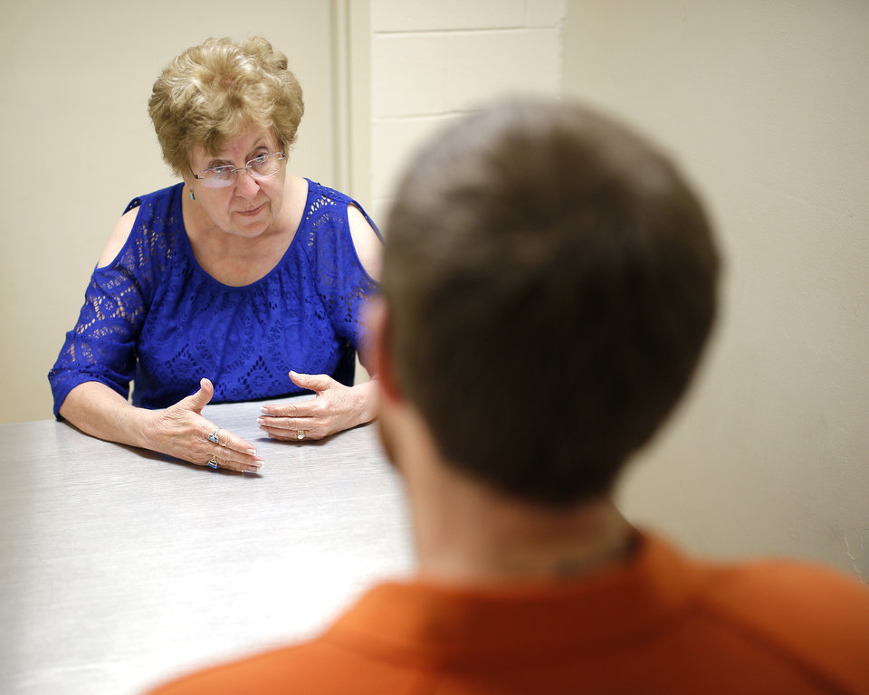 Photo - Linda Evans, a psychologist, councils an inmate at the Payne County jail in Stillwater, Okla., Tuesday, Nov. 1, 2016. Photo by Sarah Phipps, The Oklahoman