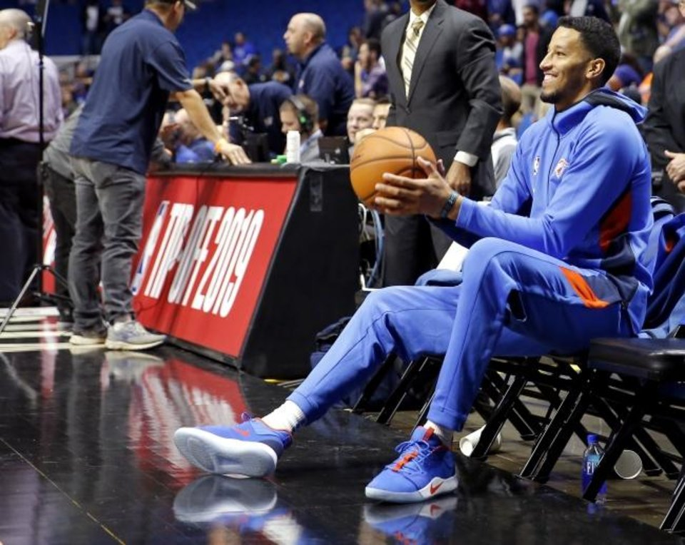 Photo -  Andre Roberson sits on the bench during warmups before the preseason game against the Mavericks at the BOK Center in Tulsa on Oct. 8, 2019. [Sarah Phipps/The Oklahoman]