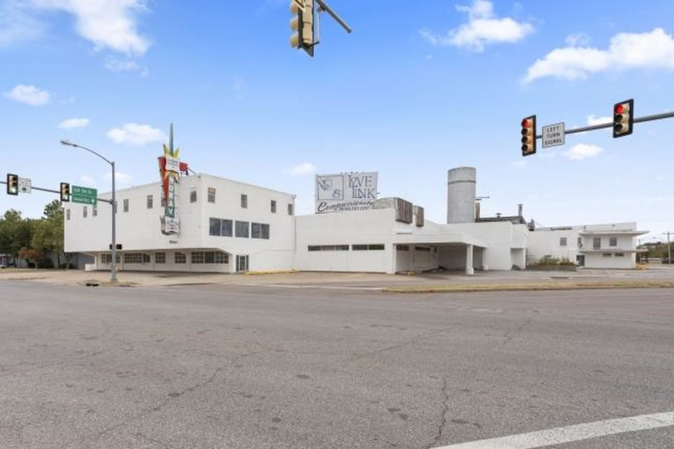 Photo -  The former NuWay Laundry, a landmark at NW 6, Western Avenue and Linwood Boulevard for the past century, is up for sale as downtown development continues to extend west. [Lindsey Torres Photography]