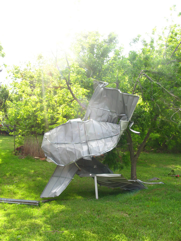 Photo - Sunday's storm twisted and destroyed a storage shed on Judy Pendergraft's property in the Hidden Valley addition in southeast Edmond. PHOTO BY LILLIE-BETH BRINKMAN, THE OKLAHOMAN