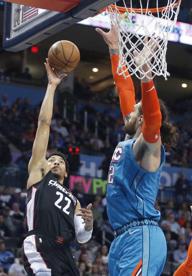 Photo - Oklahoma City's Steven Adams (12) defends Washington's Otto Porter Jr. (22) during an NBA basketball game between the Oklahoma City Thunder and the Washington Wizards at Chesapeake Energy Arena in Oklahoma City, Sunday, Jan. 6, 2019. Photo by Bryan Terry, The Oklahoman