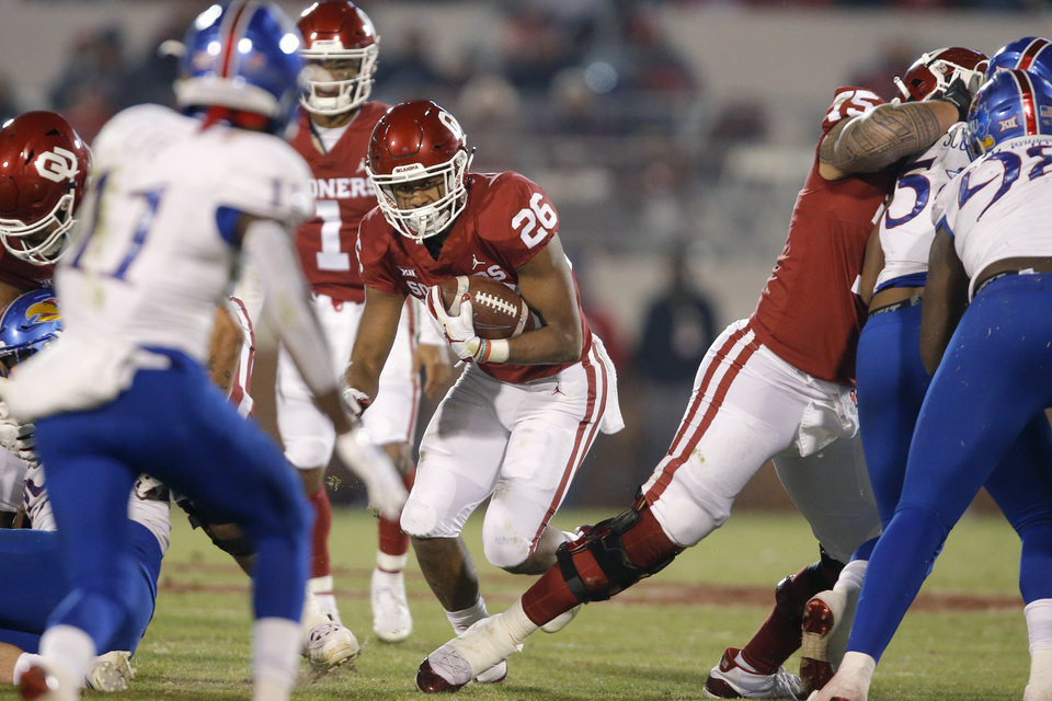 Photo - Oklahoma's Kennedy Brooks (26) carries the ball during a college football game between the University of Oklahoma Sooners (OU) and the Kansas Jayhawks (KU) at Gaylord Family-Oklahoma Memorial Stadium in Norman, Okla., Saturday, Nov. 17, 2018. Photo by Bryan Terry, The Oklahoman