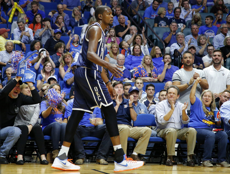 Photo -  Oklahoma City fans cheer for Oklahoma City's Kevin Durant (35) during an NBA preseason game between the Oklahoma City Thunder and the Dallas Mavericks at the BOK Center in Tulsa, Okla., Tuesday, Oct. 13, 2015. [Photo by Bryan Terry, The Oklahoman]