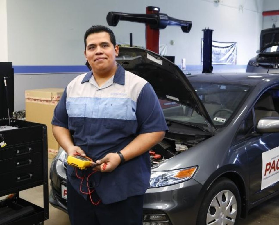 Photo -  Luis Bondi will graduate in May as a certified Honda technician with an associate degree in automotive technology from Oklahoma City Community College. [Jim Beckel/The Oklahoman]