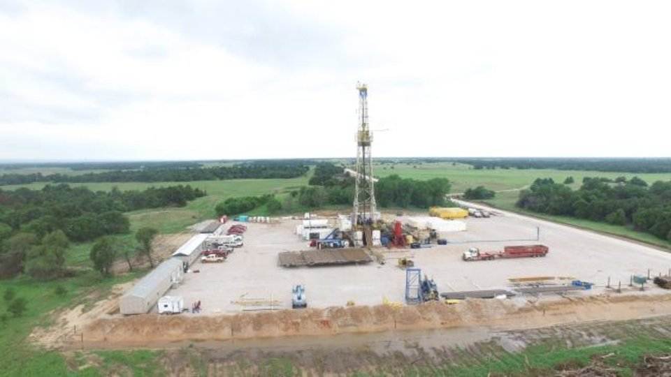 Photo -  A rig owned by Atlas Drilling is pictured operating at a Crawley Petroleum location in Dewey County earlier this month. [PROVIDED]