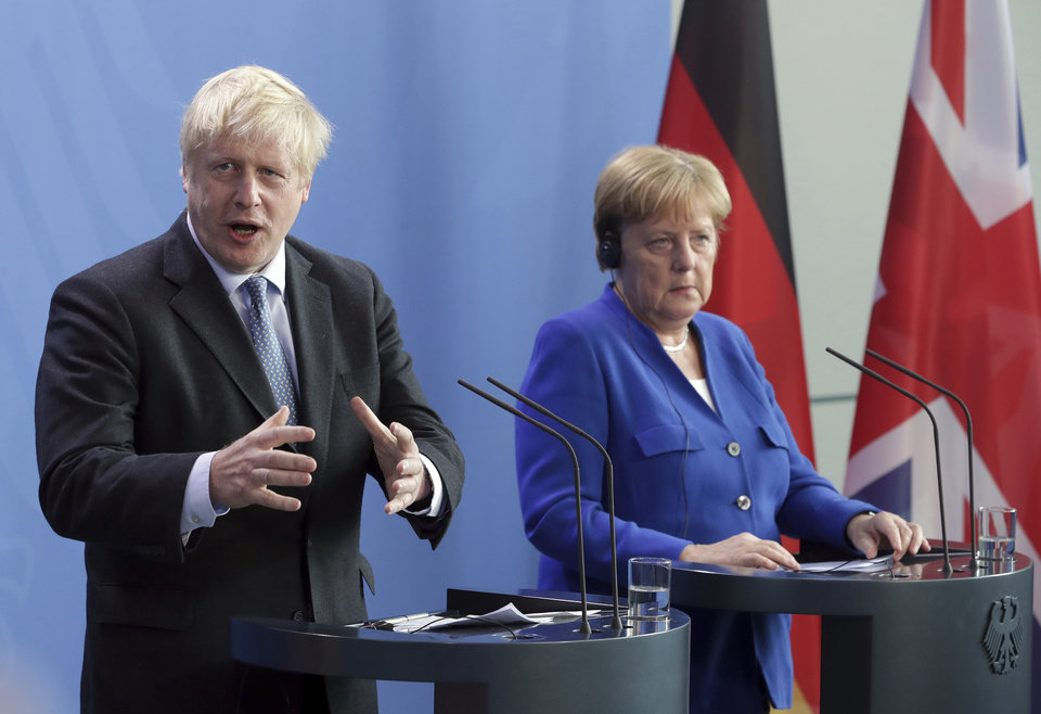 Photo -  German Chancellor Angela Merkel and Britain's Prime Minister Boris Johnson address the media during a joint press conference as part of a meeting at the Chancellery in Berlin, Germany, Wednesday, Aug. 21, 2019. (AP Photo/Michael Sohn)