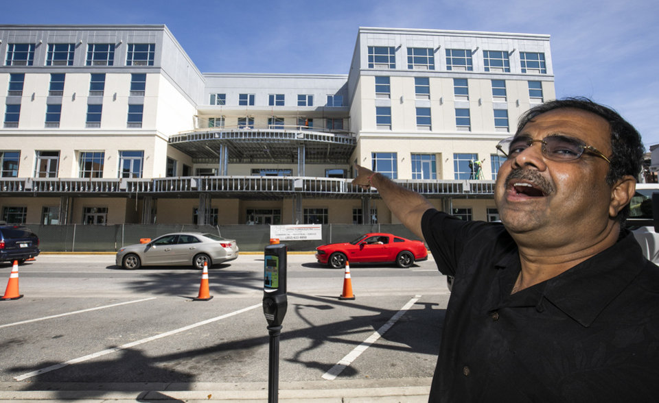 Photo -  Developer Danny Gaekwad talks about the rooftop bar on his Hilton Garden Inn hotel that was under construction Oct. 23 in Ocala, Fla. Since the coronavirus crisis started, hotel owners say they are struggling to get relief on a type of loan that Wall Street investors buy. [Doug Engle/Ocala Star-Banner via The Associated Press]