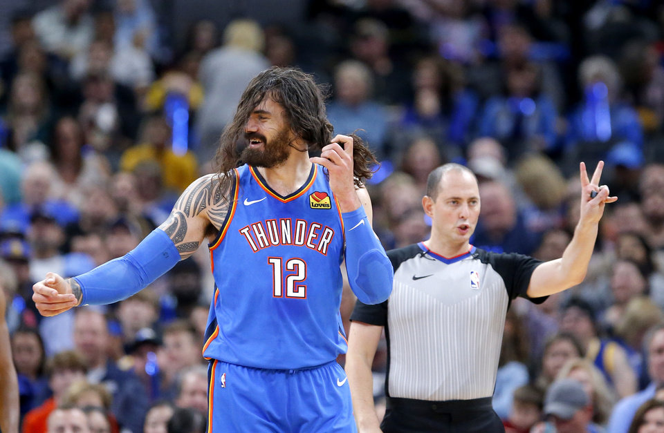 Photo - Oklahoma City's Steven Adams (12) laughs after his pony tail fell out during the NBA game between the Oklahoma City Thunder and the Golden State Warriors at Chesapeake Energy Arena,   Saturday, Nov. 9, 2019.  [Sarah Phipps/The Oklahoman]