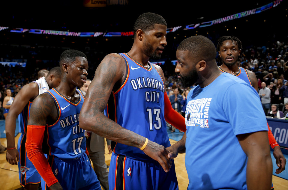 Photo - Oklahoma City's Paul George (13) greets Raymond Felton (2) as he walks off the court following the NBA game between the Oklahoma City Thunder and the Utah Jazz at the Chesapeake Energy Arena, Saturday, Feb. 23, 2019. Photo by Sarah Phipps, The Oklahoman