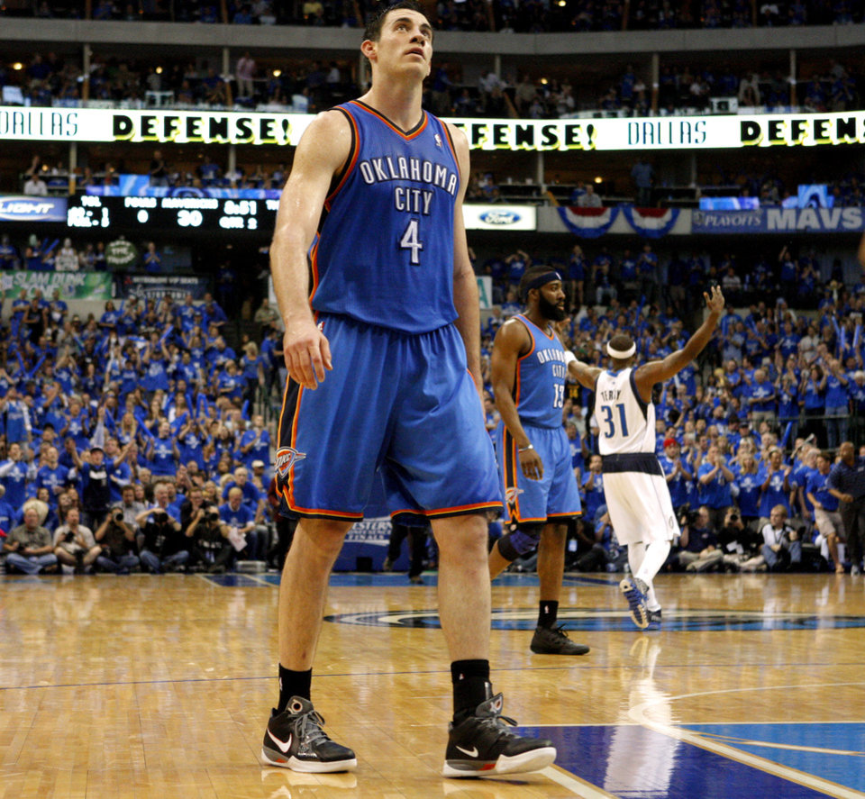 bd6955442ca Oklahoma City s Nick Collison (4) walks back to the bench during game 1 of  the Western Conference Finals in the NBA basketball playoffs between the  Dallas ...