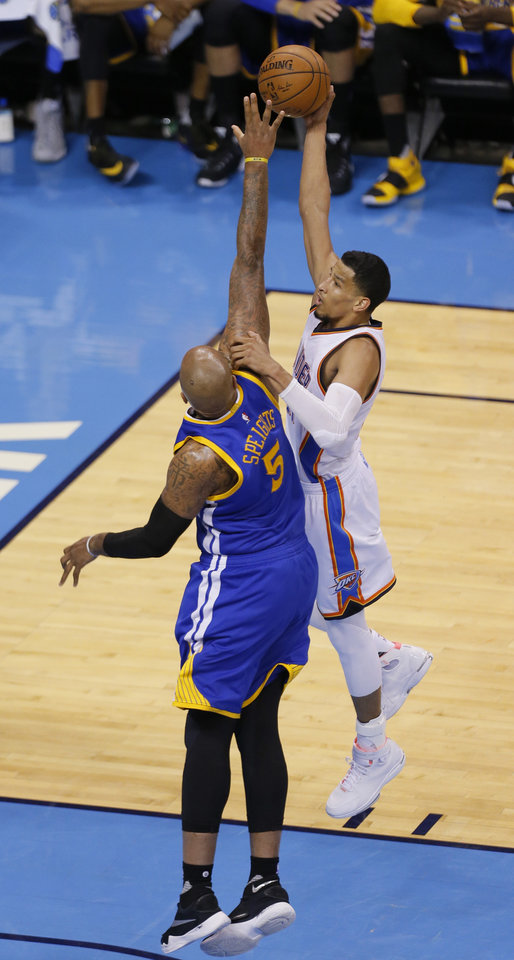 Photo - Oklahoma City's Andre Roberson (21) goes up for a basket as Golden State 's Marreese Speights (5) during Game 3 of the Western Conference finals in the NBA playoffs between the Oklahoma City Thunder and the Golden State Warriors at Chesapeake Energy Arena in Oklahoma City, Sunday, May 22, 2016. Photo by Sarah Phipps, The Oklahoman