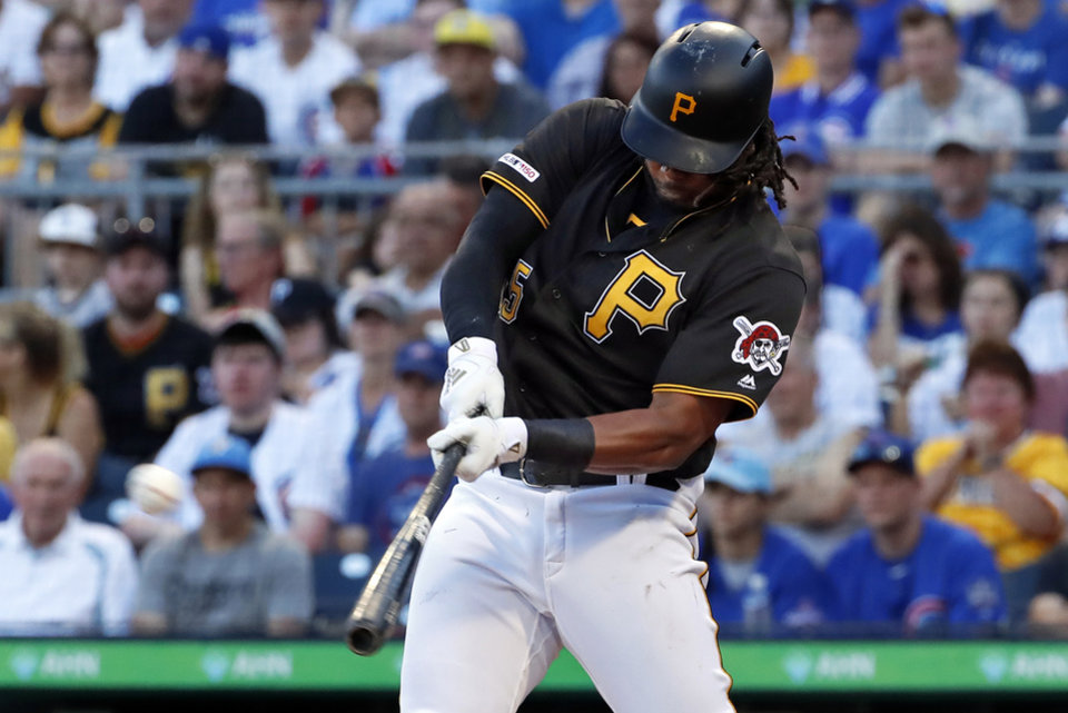 Photo -  FILE - In this July 1, 2019, file photo, Pittsburgh Pirates' Josh Bell hits a three-run home run off Chicago Cubs starting pitcher Adbert Alzolay during the first inning of a baseball game in Pittsburgh. Bell is among eight competitors in this year's All-Star Game Home Run Derby, which is handing out a $1 million prize to the winner. (AP Photo/Gene J. Puskar, File)