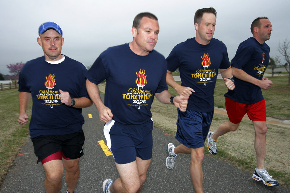 Photo - RUN, RUNNING, RACE, FUNDRAISER, FUNDRAISING: Edmond police officers Tommy Evans, Bryan Weathers, Brent Clowers and Jonathan Pruett practice for the 26K Memorial Marathon where they will raise money for the Special Olympics, Wednesday, April 9, 2008.  Photo by DAVID MCDANIEL, THE OKLAHOMAN.    ORG XMIT: KOD