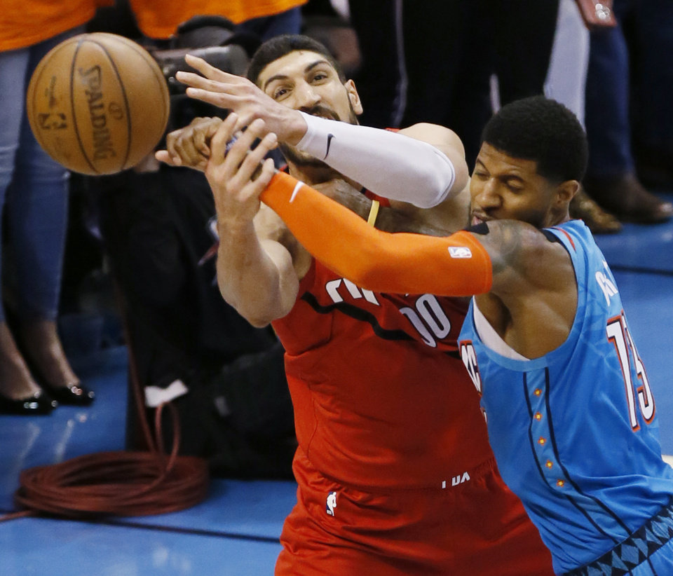 Photo - Oklahoma City's Paul George (13) and Portland's Enes Kanter (00) collide in the fourth quarter during Game 3 in the first round of the NBA playoffs between the Portland Trail Blazers and the Oklahoma City Thunder at Chesapeake Energy Arena in Oklahoma City, Friday, April 19, 2019. Oklahoma City won 120-108. Photo by Nate Billings, The Oklahoman