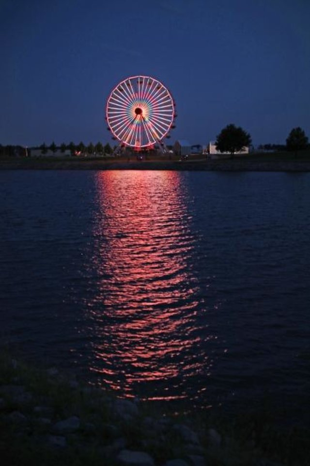 Photo -  The Wheeler Park Ferris wheel on the south shore of the Oklahoma River formerly was an attraction at the Santa Monica Pier in California. [Doug Hoke/The Oklahoman]