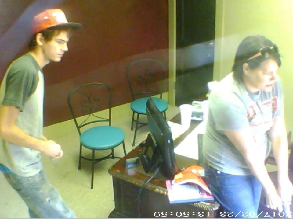 Photo -  This image from video shows Stillwater bail agent Chasity Carey, right, after shooting her client. She and her son, Justin Henderson, left, were trying to take the client into custody Aug. 9. [Video provided by Payne County district attorney's office]