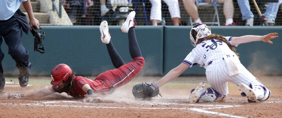 Photo - Oklahoma's Raegan Rogers (24) is tagged out at home y Northwestern's Jordyn Rudd (36) in the third inning of the second softball game in the Norman Super Regional between the University of Oklahoma (OU) and Northwestern in Norman, Okla., Saturday, May 25, 2019. Oklahoma won 8-0 to send them to the Women's College World Series. [Bryan Terry/The Oklahoman]