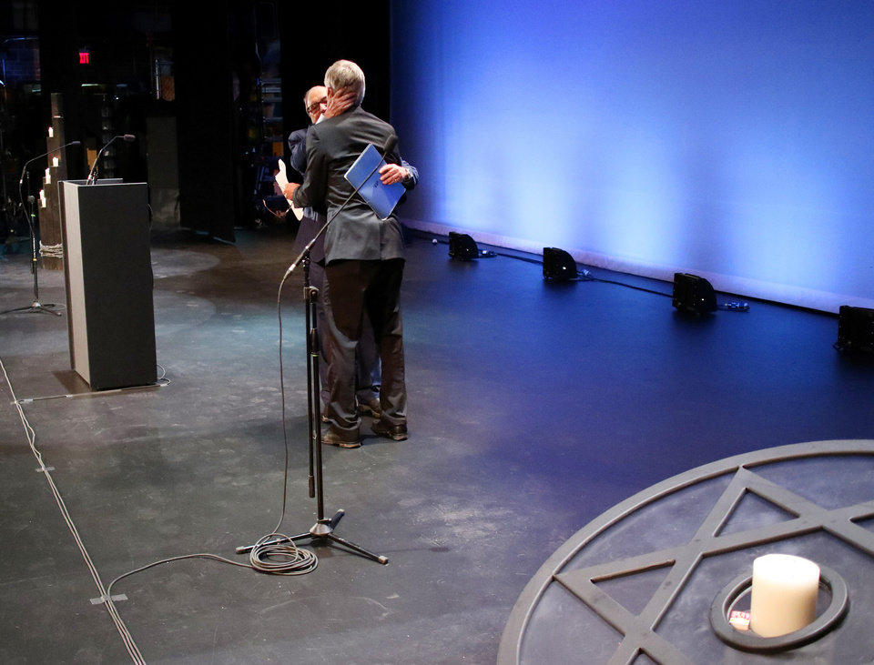 "Photo - Abraham H. Foxman, National Director Emeritus of the Anti-Defamation League, embraces David Morton, Principal of Bishop McGuinness Catholic High School after his speech at ""Testimony of a Child, the Holocaust Remembrance Day program at Bishop McGuinness High School auditorium, Sunday, May 5, 2019. [Doug Hoke/The Oklahoman]"