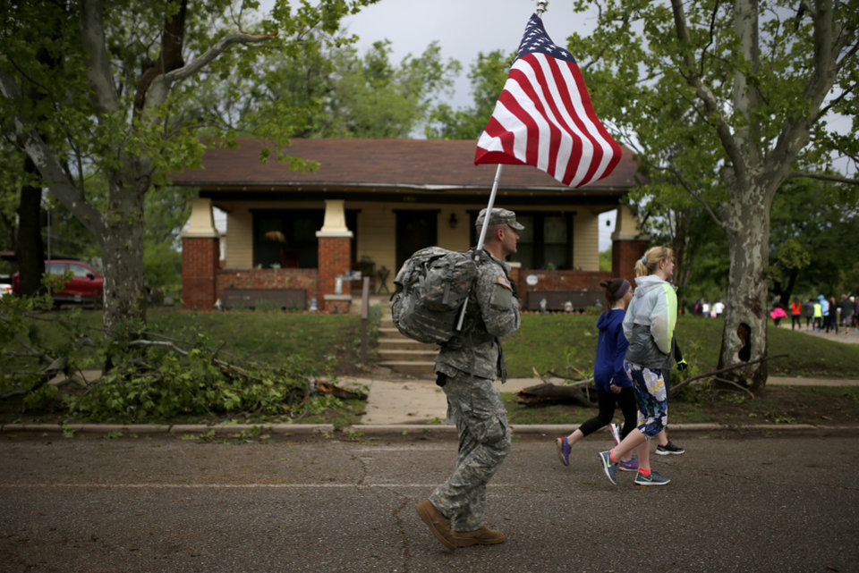 Photo - A solider walks near N. Robinson Ave and NW 28th St. during the 2017 Oklahoma City Memorial Marathon Sunday, April 30, 2017.  Photo by Sarah Phipps, The Oklahoman