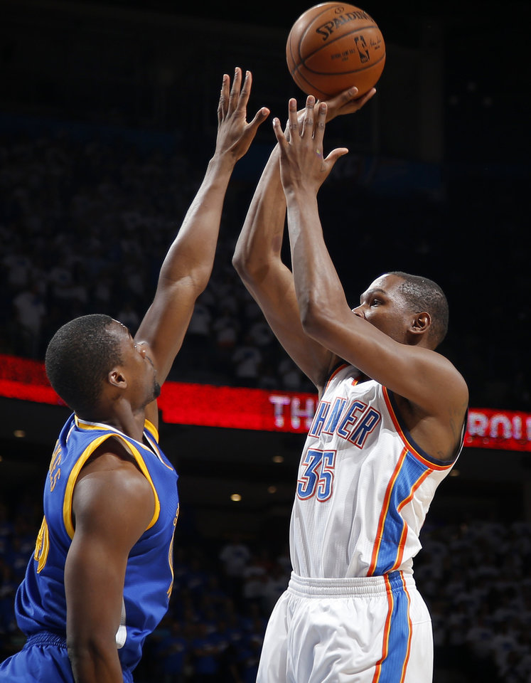Photo - Oklahoma City's Kevin Durant (35) shoots over Harrison Barnes (40) during Game 3 of the Western Conference finals in the NBA playoffs between the Oklahoma City Thunder and the Golden State Warriors at Chesapeake Energy Arena in Oklahoma City, Sunday, May 22, 2016. Oklahoma City won 133-105. Photo by Bryan Terry, The Oklahoman