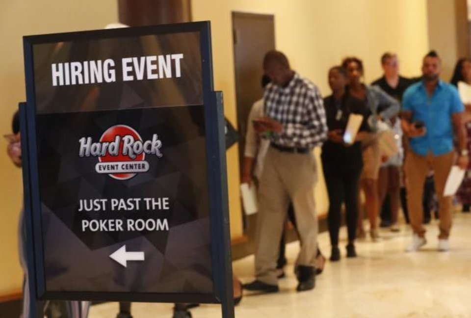 Photo -  Job applicants line up at the Seminole Hard Rock Hotel & Casino Hollywood during a job fair in Hollywood, Florida. [AP PHOTO]