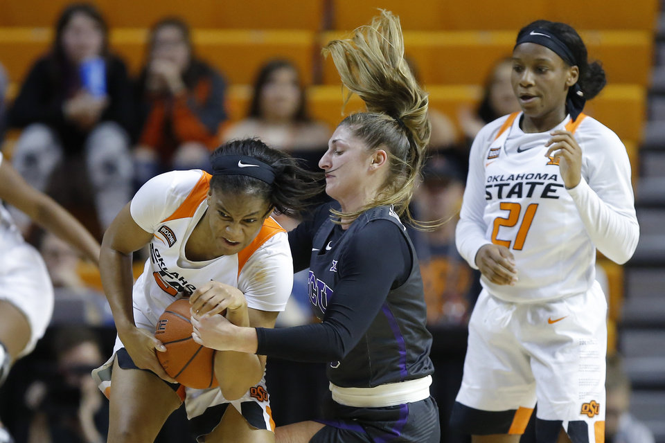 Photo - Oklahoma State's Lauren Fields (23) fights for the ball with TCU's Jaycee Bradley (10) during a women's NCAA basketball game between the Oklahoma State University Cowgirls (OSU) and the TCU Horned Frogs at Gallagher-Iba Arena in Stillwater, Okla., Wednesday, Jan. 29, 2020. Oklahoma State lost 72-68. [Bryan Terry/The Oklahoman]