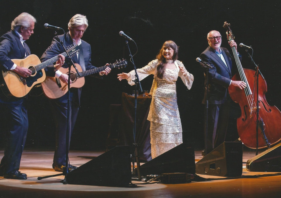 Photo -  The Seekers onstage in the UK in 2014 during their sold-out