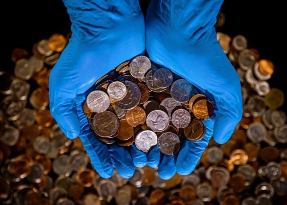Photo -  The U.S. Federal Reserve Bank is experiencing a supply problem involving coins after a coronavirus-caused economic shutdown and a subsequent restart. While the nation has a below-normal supply of pennies, nickels, dimes and quarters, it has ample supplies of paper money, officials say. [By Chris Landsberger/The Oklahoman]