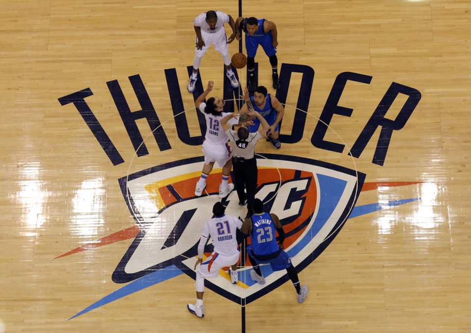 Photo - Game 5 tips off of the first round series between the Oklahoma City Thunder and the Dallas Mavericks in the NBA playoffs at Chesapeake Energy Arena in Oklahoma City, Monday, April 25, 2016. Photo by Sarah Phipps, The Oklahoman