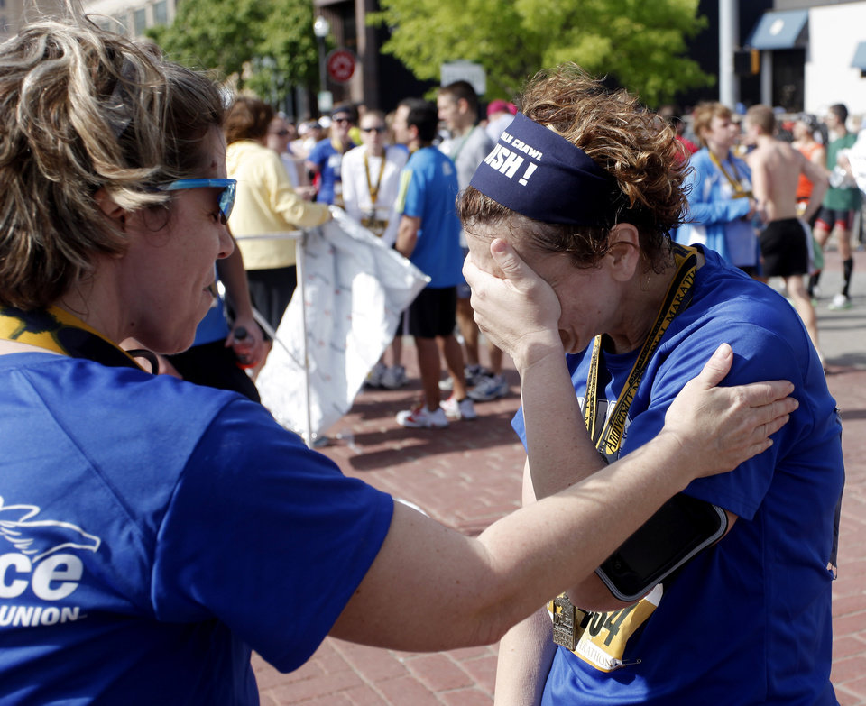 Photo - ALFRED P. MURRAH FEDERAL BUILDING BOMBING SURVIVOR: Allegiance Credit Union runner Terri Talley consoles Amy Petty when she is overcome by emotions after the half marathon during the 10th anniversary of the Oklahoma City Memorial Marathon Sunday, April 25, 2010 in Oklahoma City. Talley and Petty were injured during the bombing fifteen years ago. Photo by Doug Hoke, The Oklahoman. ORG XMIT: KOD