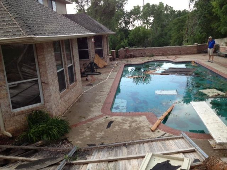 Photo - Storm damage at a home in Edmond. Photo by Diana Baldwin