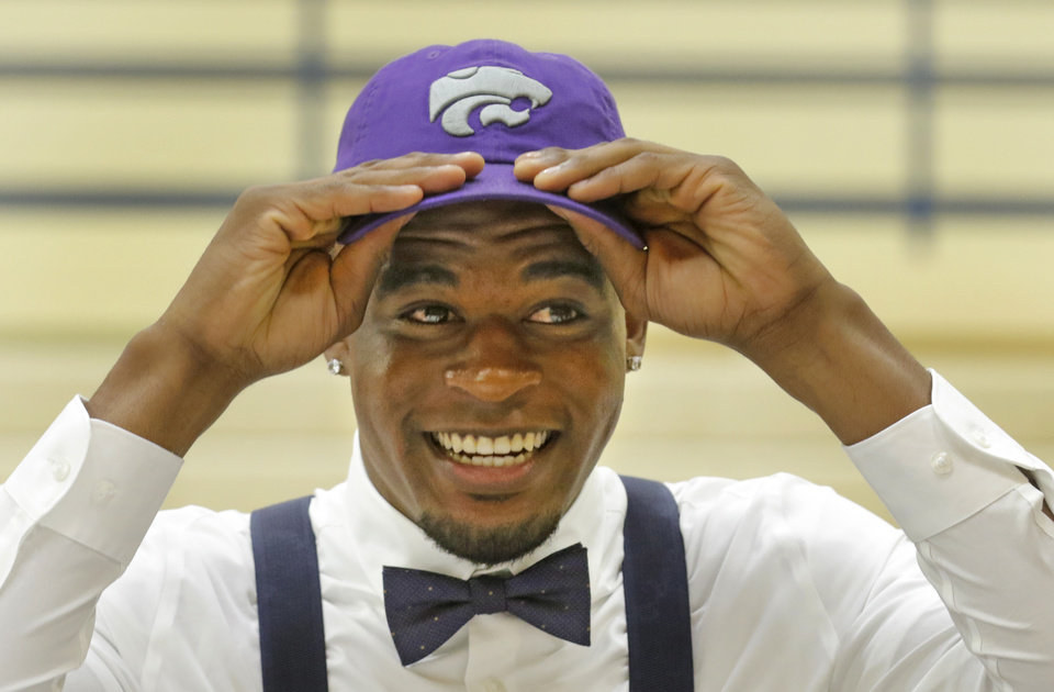 Photo -  Southmoore's Gervarrius Owens signed with Kansas State on Wednesday. [PHOTO BY STEVE GOOCH, THE OKLAHOMAN]