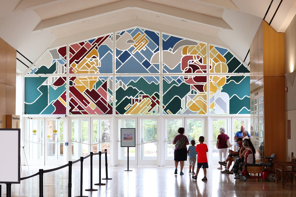 Photo -  John Salame's window murals at the National Cowboy & Western Heritage Museum are part of a series of exhibits and installations around OKC called