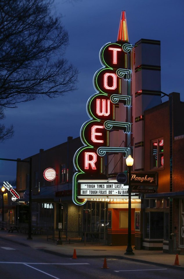 Photo - The Tower Theatre and other businesses are seen in the Uptown District along NW 23 between Walker Avenue and Hudson Avenue in Oklahoma City, Thursday, March 26, 2020. [The Oklahoman Archives]